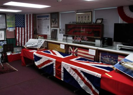 HMS Sheffield flag draped over a display table