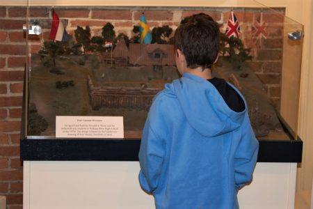 Visitor examining a diorama depicting Fort Casimir.