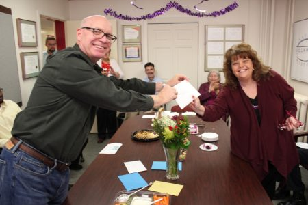 Cherie Dodge Biron accepting a card from Division of Historical and Cultural Affairs Director Tim Slavin during her farewell gathering on Nov. 17, 2017.