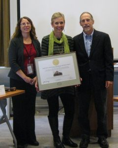 (From left) Gwen Davis; Deborah Martin, Wilmington historic preservation planner, who accepted the certificate on behalf of the property owners in the Downtown Wilmington Commercial Historic District; and John Martin