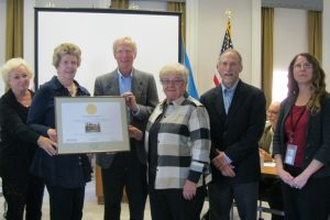 Accepting the certificate for the Dinker-Irvin Cottage which is owned by the town of Bethany Beach. (From left) Jan Kinsella, member of the Bethany Beach Cultural and Historic Affairs Committee; Christina and Clement Edgar who donated the cottage to the town; and Carol Olmstead, chair of the Cultural and Historic Affairs Committee. Joining them are John Martin and Gwen Davis