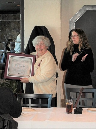Alice Guerrant holding her Lifetime Achievement Award from the Division of Historical and Cultural Affairs. The award was presented during Guerrant's retirement luncheon on Jan. 26, 2018. Deputy State Historic Preservation Officer Gwen Davis looks on.