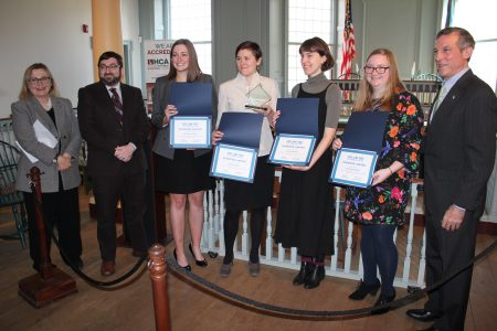 Winners of the Delaware Museum Association's Delaware Diamond Award holding their award certificates. From left: Dr. Kasey Grier, director of the Museum Studies Program at the University of Delaware; Dan Citron, executive director of the New Castle Historical Society and president of the Delaware Museum Association; award winners Kathryn Lenart, Sharon Hess, Tess Frydman and Sara McNamara; and Gov. John Carney