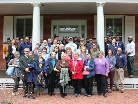 Division of Historical and Cultural Affairs staff members gathered on the front porch of the Buena Vista mansion