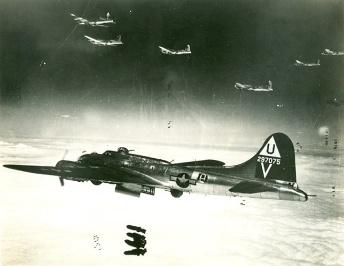 Group of B-17 Flying Fortresses dropping bombs