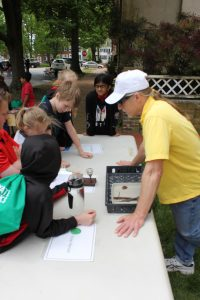 State Historic Preservation Office archaeologist John Martin working with a group of students.