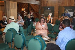 Photo of symposium attendees attending a reception at the John Dickinson Plantation.