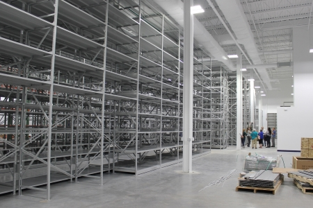 Photo of shelves at the State of Delaware Center for Material Culture with staff members in the background