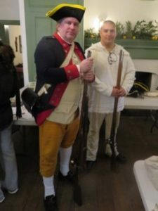 "Photo of Revolutionary War historical re-enactor Chris Mlynarcyzk (left) of the First Delaware Regiment and an unidentified ""recruit."""