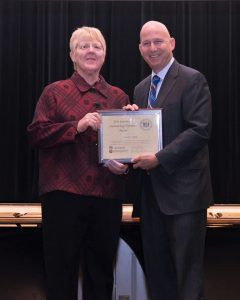 Photo of Carolyn Apple receiving a Governor's Outstanding Volunteer Award from Gov. Markell in 2016.