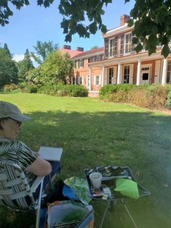 Photo of Mary Lou Hamilton of the Sunshine Plein Air Artists painting on the grounds of Buena Vista on July 28, 2020.
