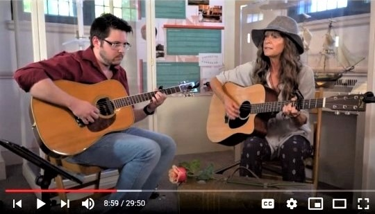 "YouTube screenshot of Cathy Jane and Adam Clifton performing at the Zwaanendael Museum as part of the ""At Home Concert Series"" on July 21, 2020."