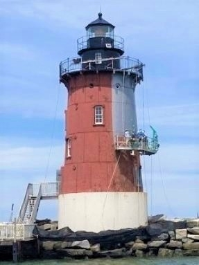 Photo of the Delaware Breakwater East End Lighthouse with painting in progress