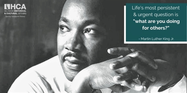 "Photo of Dr. Martin Luther King Jr. with quote, ""Life's most persistent and urgent question is 'what are you doing for others'."""