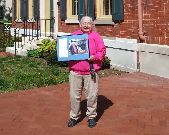 Photo of Alice Guerrant holding her Delaware Department of State Employee of the Fourth Quarter award.