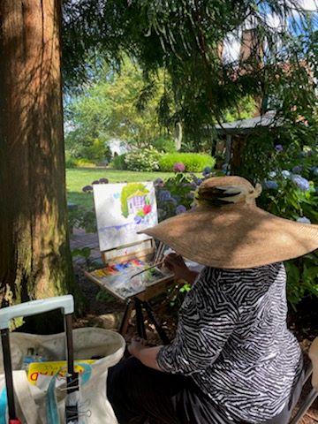 Photo of Martha Pelleggi painting at Buena Vista