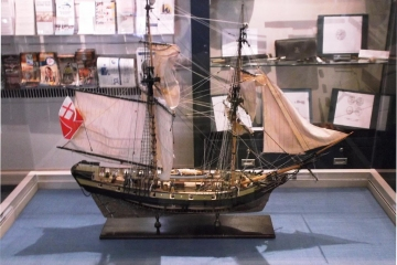 A model ship that is two-feet tall.