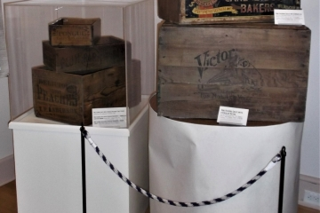 A section of the Delaware Railroads exhibit featuring shipping crates on pedestals