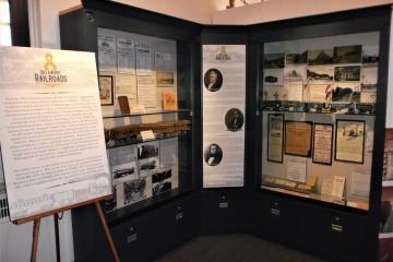 Exhibit cases in corner of railroad exhibit.